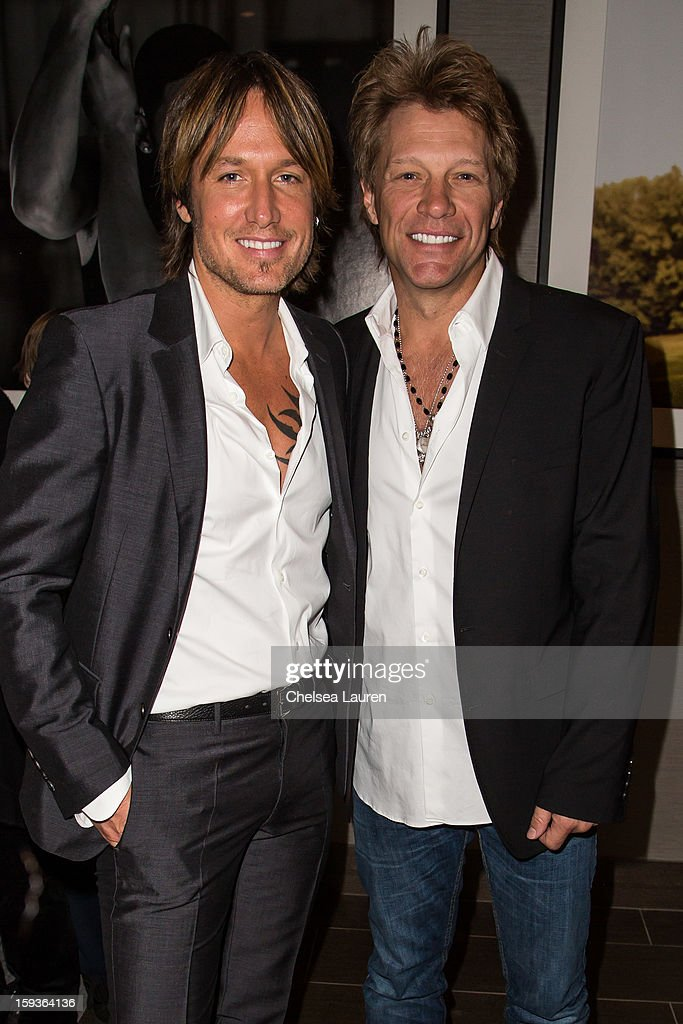 Musicians <a gi-track='captionPersonalityLinkClicked' href=/galleries/search?phrase=Keith+Urban&family=editorial&specificpeople=202997 ng-click='$event.stopPropagation()'>Keith Urban</a> (L) and <a gi-track='captionPersonalityLinkClicked' href=/galleries/search?phrase=Jon+Bon+Jovi&family=editorial&specificpeople=201527 ng-click='$event.stopPropagation()'>Jon Bon Jovi</a> attend CW3PR Presents the inaugural 'Gold Meets Golden' event at New Flagship Equinox Sports Club on January 12, 2013 in Los Angeles, California.