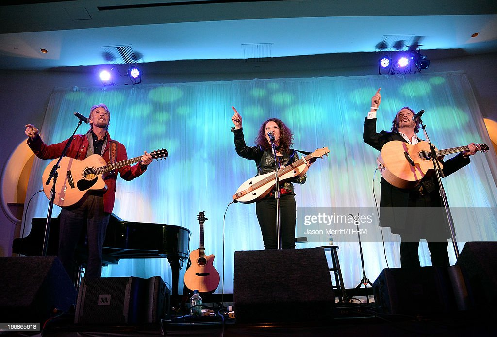 Musicians <a gi-track='captionPersonalityLinkClicked' href=/galleries/search?phrase=Kenny+Loggins&family=editorial&specificpeople=640646 ng-click='$event.stopPropagation()'>Kenny Loggins</a>, Georgia Middleman, and Gary Burr of Blue Sky Riders perform onstage during The Kaleidoscope Ball - Designing The Future benefitting the UCLA Children's Discovery and Innovation Institute at Mattel Children's Hospital UCLA at Beverly Hills Hotel on April 17, 2013 in Beverly Hills, California.