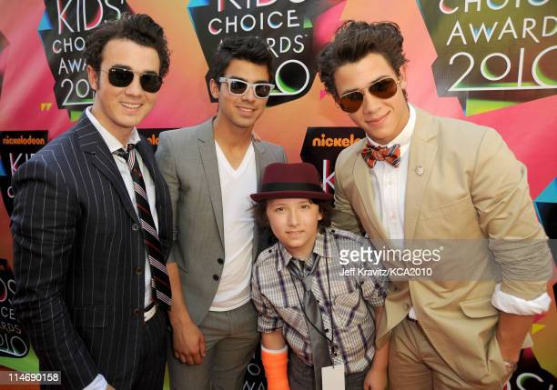 Musicians Kevin Jonas Joe Jonas and Nick Jonas of Jonas Brothers with brother Frankie Jonas arrive at Nickelodeon's 23rd Annual Kids' Choice Awards...