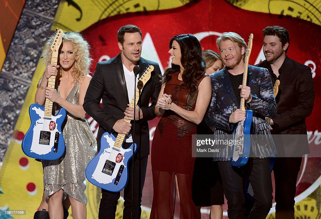 Musicians Kimberly Roads Schlapman, Jimi Westbrook, Karen Fairchild and Phillip Sweet of Little Big Town accept the award for Music Video of the Year: Group from presenters LeAnn Rimes and Chris Young onstage during the 2012 American Country Awards at the Mandalay Bay Events Center on December 10, 2012 in Las Vegas, Nevada.