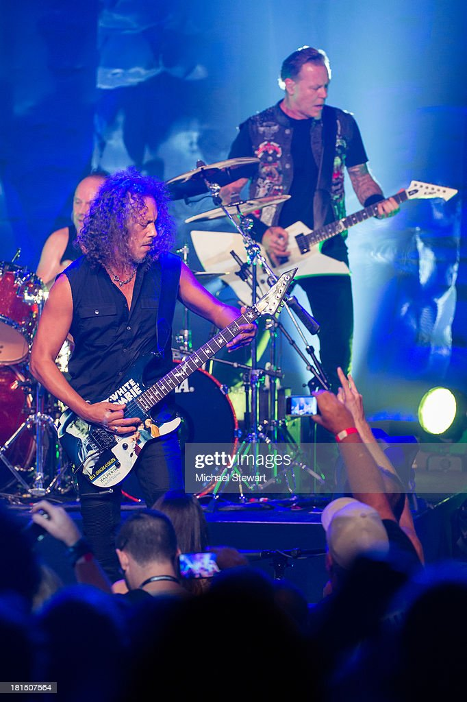 Musicians Kirk Hammett (L) and James Hetfield of Metallica perform at a private exclusive concert for SiriusXM listeners at The Apollo Theater on September 21, 2013 in New York City.