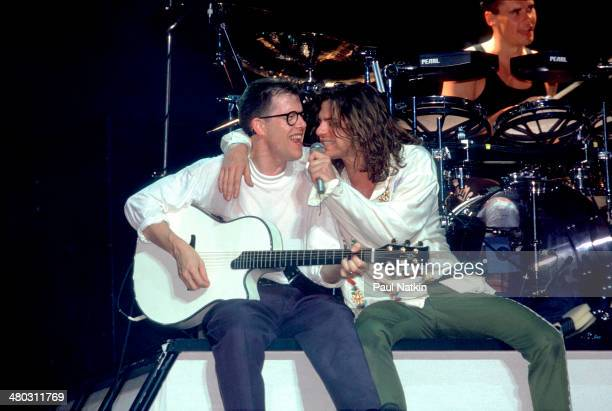 Musicians Kirk Pengilly and Michael Hutchence of the band INXS perform onstage Miami Florida March 1 1988