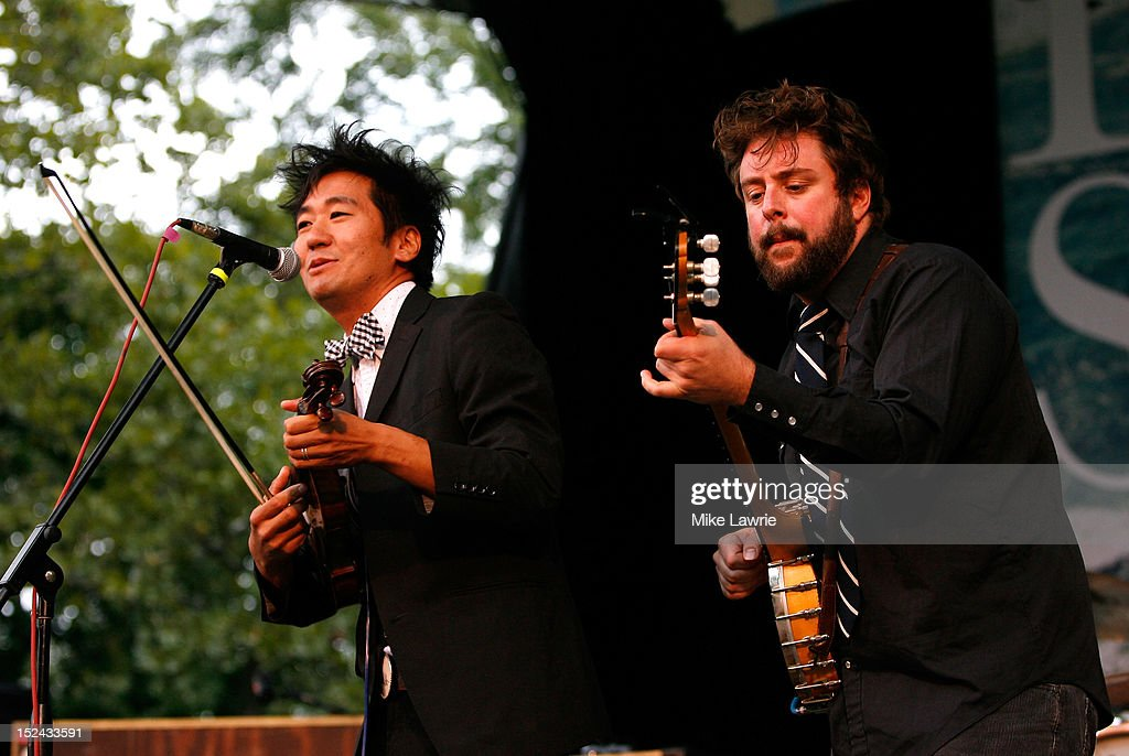 Musicians Kishi Bashi (L) and Mike Savino of Tall Tall Trees perform at SummerStage at Rumsey Playfield, Central Park on September 20, 2012 in New York City.