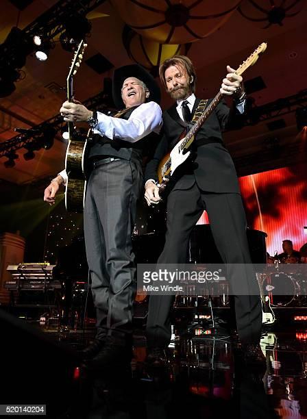Musicians Kix Brooks and Ronnie Dunn of Brooks Dunn perform onstage during Muhammad Ali's Celebrity Fight Night XXII at the JW Marriott Phoenix...
