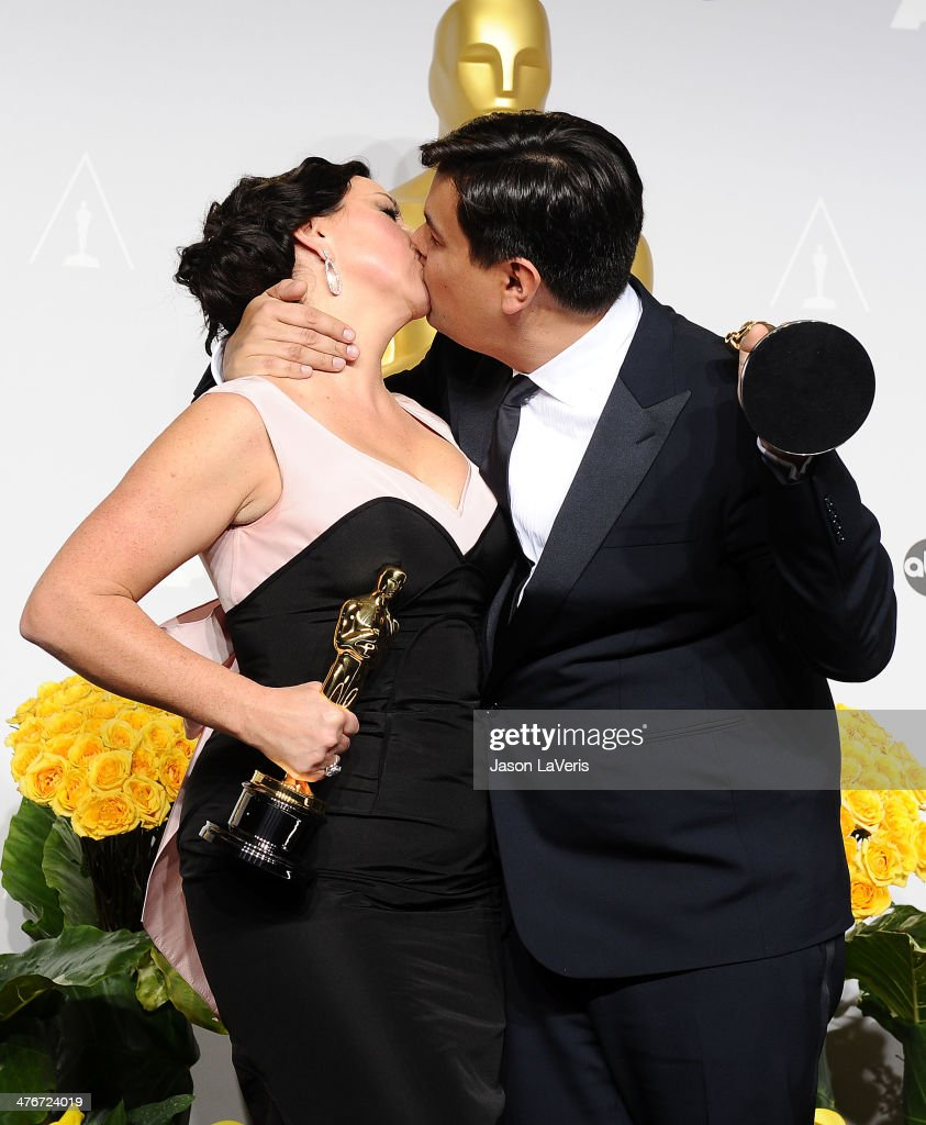 Musicians Kristen Anderson-Lopez (L) and Robert Lopez pose in the press room at the 86th annual Academy Awards at Dolby Theatre on March 2, 2014 in Hollywood, California.