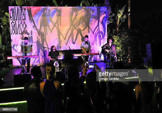 Musicians Kyle Simmons Chris 'Woody' Wood Dan Smith and Will Farquarson of Bastille perform during the Launch Of CHOO08 hosted by Jimmy Choo's Sandra...