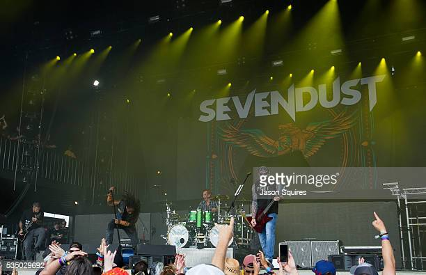 Musicians Lajon Witherspoon Clint Lowery John Connolly Vince Hornsby and Morgan Rose of Sevendust perform at Catch The Fever Festival Grounds on May...