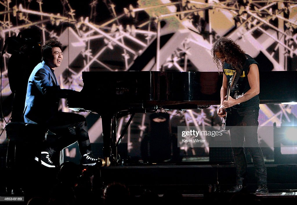 Musicians Lang Lang and Kirk Hammett perform onstage during the 56th GRAMMY Awards at Staples Center on January 26 2014 in Los Angeles California
