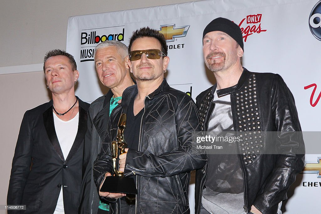 Musicians Larry Mullen Jr Adam Clayton Bono and The Edge of U2 attend the 2011 Billboard Music Awards press room held at MGM Grand Garden Arena on...
