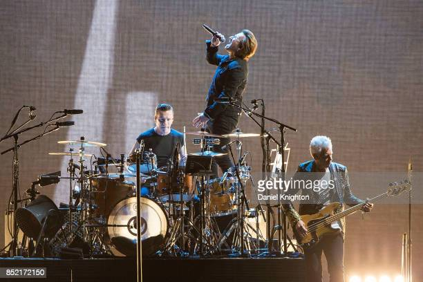 Musicians Larry Mullen Jr Bono and Adam Clayton of U2 perform on stage on the final night of U2 The Joshua Tree Tour 2017 at SDCCU Stadium on...