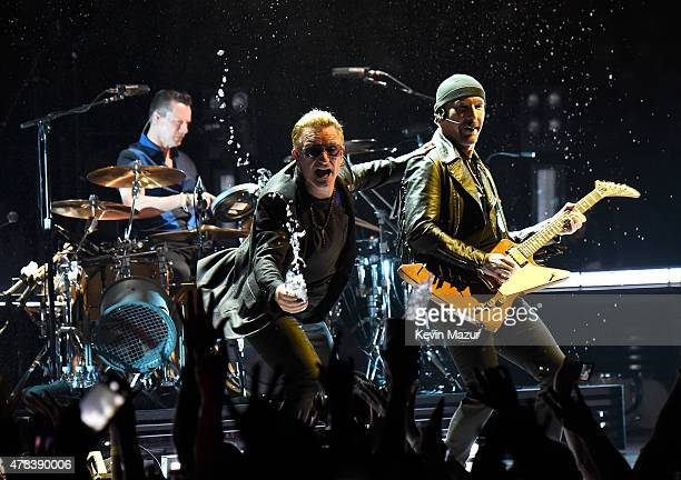 Musicians Larry Mullen Jr Bono and The Edge of U2 perform onstage during the U2 iNNOCENCE eXPERIENCE tour opener in Vancouver at Rogers Arena on May...