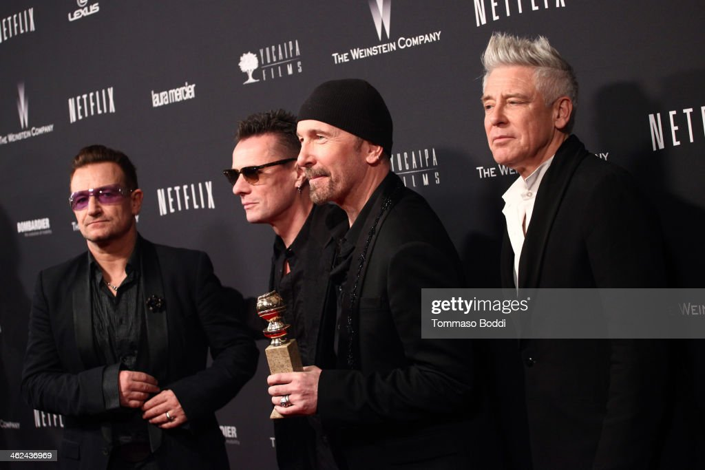 Musicians <a gi-track='captionPersonalityLinkClicked' href=/galleries/search?phrase=Larry+Mullen+Jr.&family=editorial&specificpeople=211542 ng-click='$event.stopPropagation()'>Larry Mullen Jr.</a>, <a gi-track='captionPersonalityLinkClicked' href=/galleries/search?phrase=Bono+-+Singer&family=editorial&specificpeople=167279 ng-click='$event.stopPropagation()'>Bono</a>, The Edge and Adam Clayton of music group U2 attends the Weinstein Company's 2014 Golden Globe Awards after party on January 12, 2014 in Beverly Hills, California.
