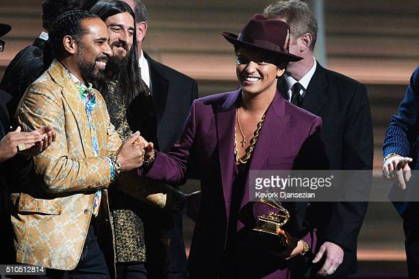 Musicians Lawrence Boo Mitchell and Bruno Mars accept the Record Of The Year award for 'Uptown Funk' onstage during The 58th GRAMMY Awards at Staples...