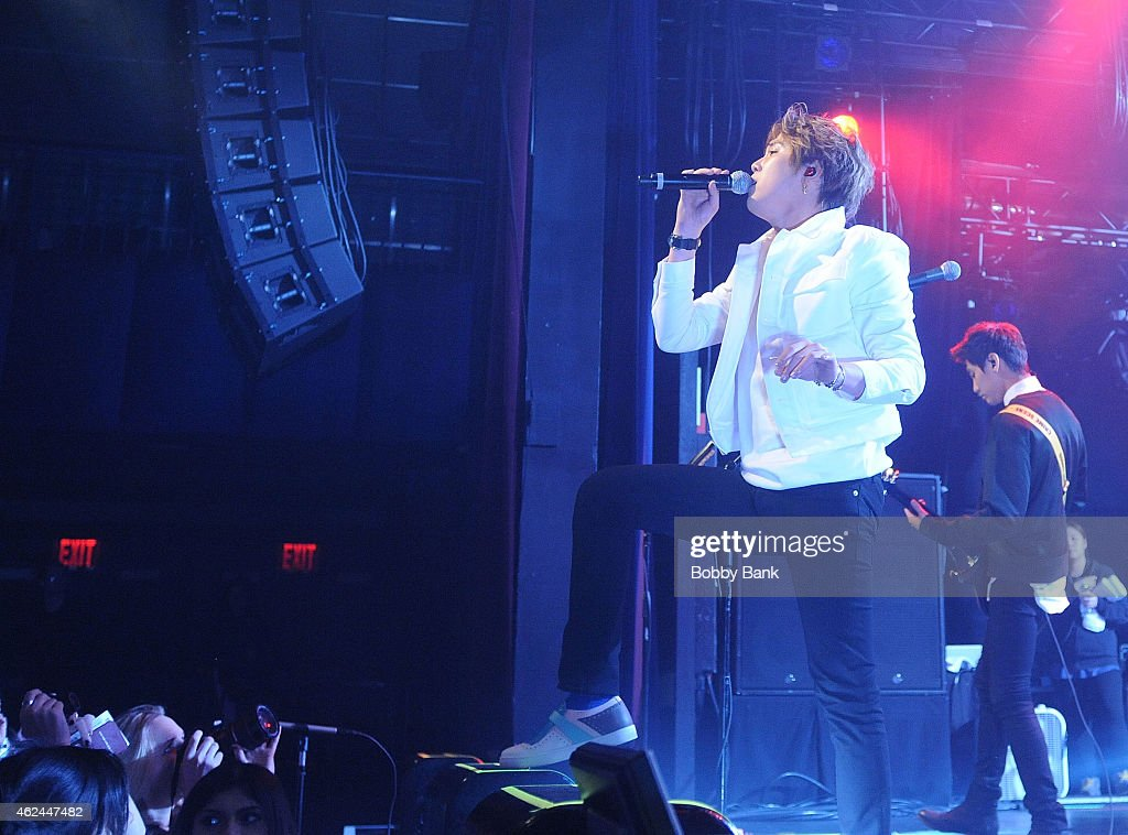 Musicians Lee Honggi and Song Seunghyun of the South Korean pop rock band FT Island performs at Best Buy Theater on January 28 2015 in New York City