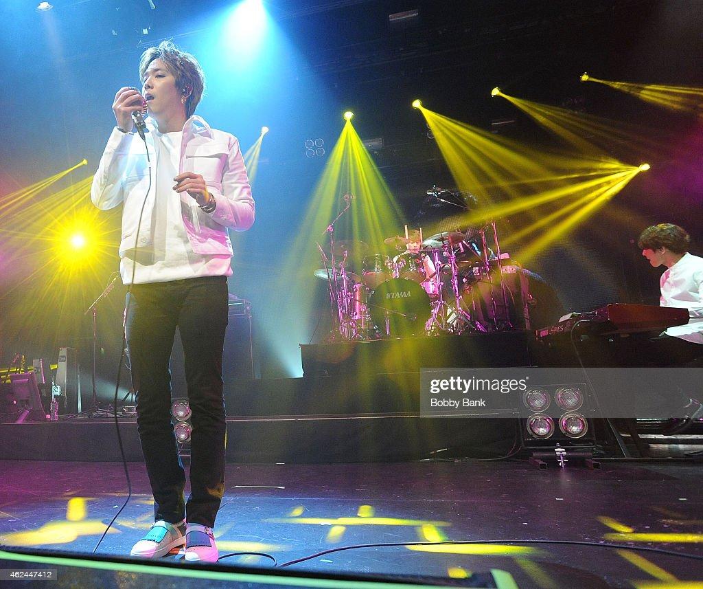 Musicians Lee Honggi Choi Jonghoon Choi Minhwan Song Seunghyun and Lee Jaejin of the South Korean pop rock band FT Island performs at Best Buy...