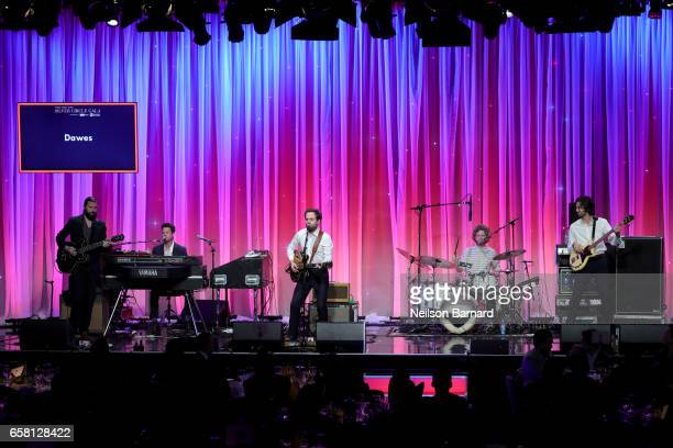 Musicians Lee Pardini Taylor Goldsmith Griffin Goldsmith Wylie Gelber of Dawes perform onstage at the Venice Family Clinic Silver Circle Gala 2017...
