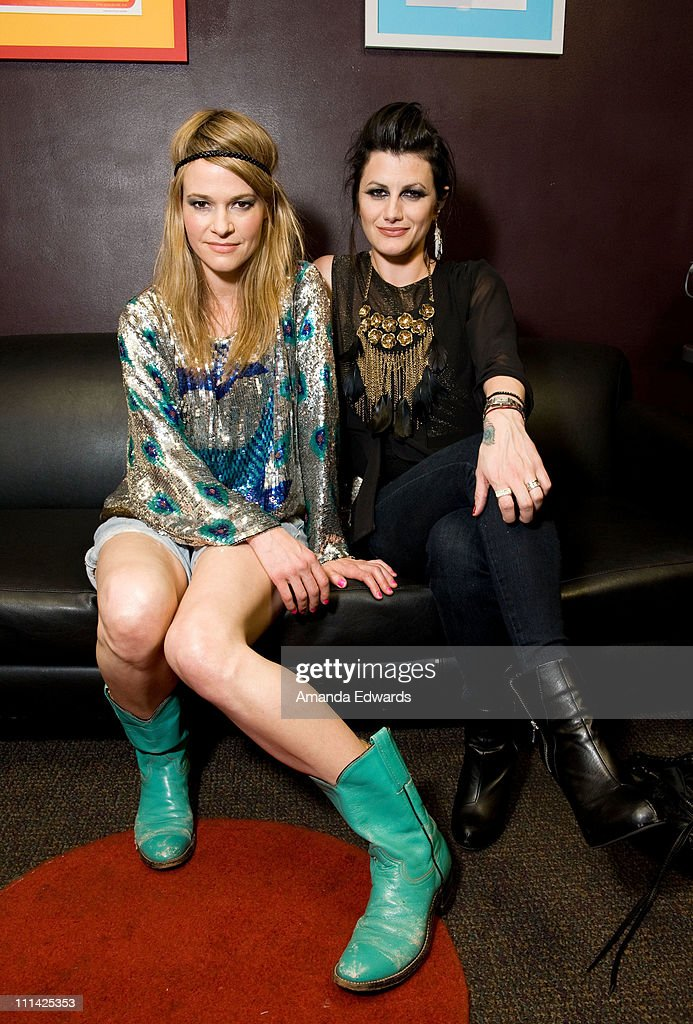 Musicians <a gi-track='captionPersonalityLinkClicked' href=/galleries/search?phrase=Leisha+Hailey&family=editorial&specificpeople=240479 ng-click='$event.stopPropagation()'>Leisha Hailey</a> (L) and Camila Grey of Uh Huh Her pose backstage before their performance at The El Rey Theatre on April 1, 2011 in Los Angeles, California.