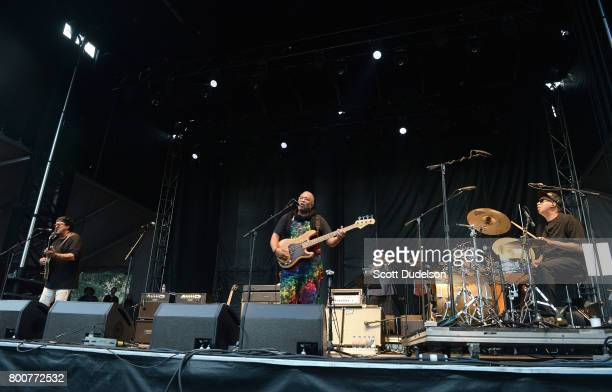 Musicians Leo Nocentelli George Porter Jr and Zigaboo Modeliste of The Meters perform onstage during Arroyo Seco Weekend at the Brookside Golf Course...