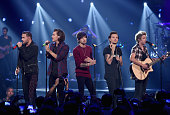 Musicians Liam Payne Harry Styles Zayn Malik Louis Tomlinson and Niall Horan of One Direction perform onstage during the 2014 iHeartRadio Music...