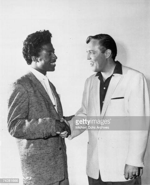 Musicians Little Richard and Bill Haley shake hands for a portrait in 1956