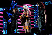 Musicians Lucinda Williams Emmylou Harris and Patty Griffin perform at the 2010 MusiCares Person Of The Year Tribute To Neil Young at the Los Angeles...