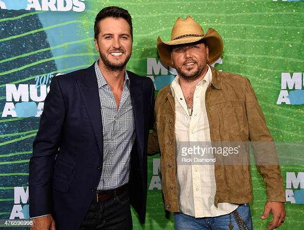 Musicians Luke Bryan and Jason Aldean attend the 2015 CMT Music awards at the Bridgestone Arena on June 10 2015 in Nashville Tennessee