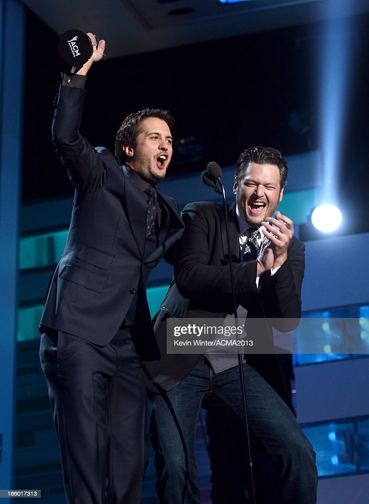 Musicians <a gi-track='captionPersonalityLinkClicked' href=/galleries/search?phrase=Luke+Bryan&family=editorial&specificpeople=4001956 ng-click='$event.stopPropagation()'>Luke Bryan</a> winner of the award for Entertainer of the Year (L) and <a gi-track='captionPersonalityLinkClicked' href=/galleries/search?phrase=Blake+Shelton&family=editorial&specificpeople=2352026 ng-click='$event.stopPropagation()'>Blake Shelton</a> speak onstage during the 48th Annual Academy of Country Music Awards at the MGM Grand Garden Arena on April 7, 2013 in Las Vegas, Nevada.