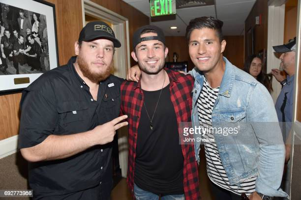 Musicians Luke Combs Michael Ray and Dan Smyers of Dan Shay take photos backstage during the 8th annual Darius Friends concert to benefit St Jude's...