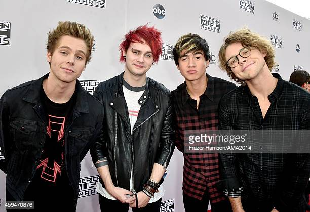 Musicians Luke Hemmings Michael Clifford Calum Hood and Ashton Irwin of 5 Seconds of Summer attend the 2014 American Music Awards at Nokia Theatre LA...