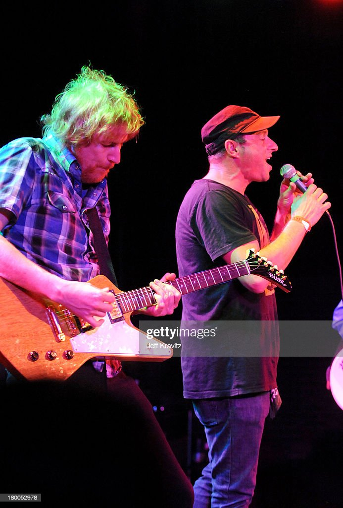 Musicians Lyle Workman and Dan Bern of Infant Sorrow and Friends perform onstage during Get Him To The Greek at The Roxy Theatre on May 24 2010 in...