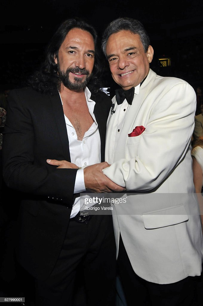 Musicians Marco Antonio Solis and Jose Jose attend the Univision and the Latin Recording Academy honor Jose Jose at the Bank United Center on July 24...