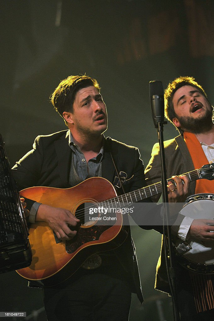 Musicians Marcus Mumford and 'Country' Winston Marshall of Mumford Sons perform onstage at MusiCares Person Of The Year Honoring Bruce Springsteen at...