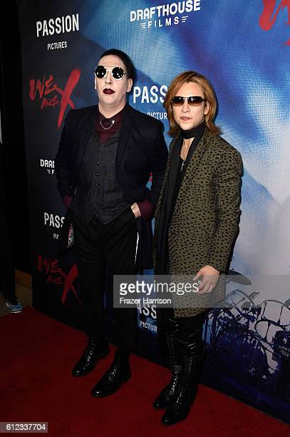 Musicians Marilyn Manson and Yoshiki attend the premiere of Drafthouse Films' 'We Are X' at TCL Chinese Theatre on October 3 2016 in Hollywood...