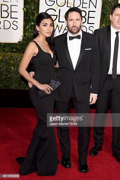 Musicians Mariqueen Maandig Reznor and Trent Reznor attend the 72nd Annual Golden Globe Awards at The Beverly Hilton Hotel on January 11 2015 in...