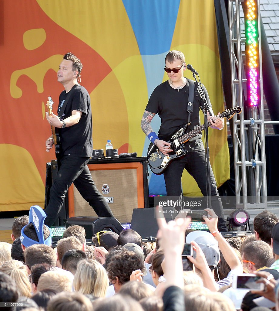 Musicians Mark Hoppus (L) and Matt Skiba of band Blink 182 perform On ABC's 'Good Morning America' at SummerStage at Rumsey Playfield, Central Park on July 1, 2016 in New York City.