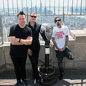 Musicians Mark Hoppus Matt Skiba and Travis Barker of the band Blink182 visit the Empire State Building to promote their new album 'California' on...