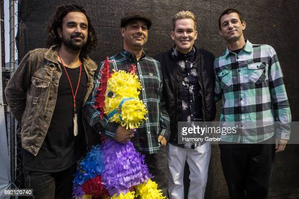 Musicians Mark McGrath Rodney Sheppard Dean Butterworth and Kristian Attard of the group Sugar Ray pose backstage for a portrait at Queen Mary's Rock...