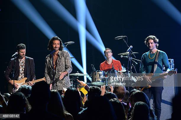 Musicians Mark Pellizzer Nasri Atweh Alex Tanas and Ben Spivak of MAGIC perform onstage at Fashion Rocks 2014 presented by Three Lions Entertainment...