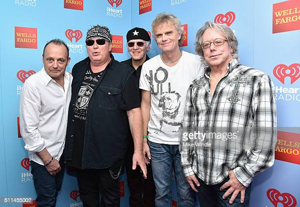 Musicians Matt Frenette Mike Reno Paul Dean Doug Johnson and Ken Sinnaeve of Loverboy pose backstage during the first ever iHeart80s Party at The...