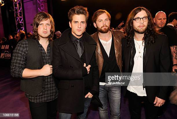 Musicians Matthew Followill Jared Followill Caleb Followill and Nathan Followill of Kings of Leon attend the MTV Europe Awards 2010 at the La Caja...