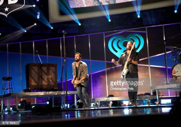 Musicians Matthew Ramsey and Geoff Sprung of Old Dominion perform onstage during the 2017 iHeartCountry Festival A Music Experience by ATT at The...