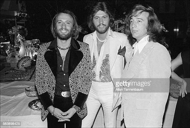 Musicians Maurice Barry and Robin Gibb of the group the Bee Gees pose at the group's 20th anniversary party at the Promenade Cafe in Rockefeller...