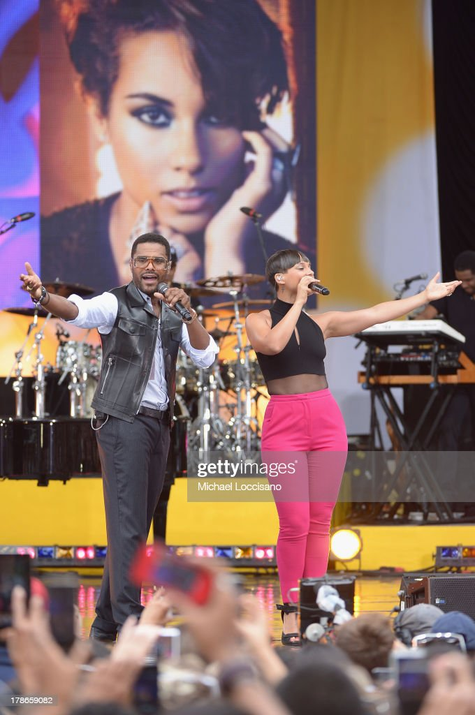 Musicians Maxwell and <a gi-track='captionPersonalityLinkClicked' href=/galleries/search?phrase=Alicia+Keys&family=editorial&specificpeople=169877 ng-click='$event.stopPropagation()'>Alicia Keys</a> perform on ABC's 'Good Morning America' at Rumsey Playfield on August 30, 2013 in New York City.