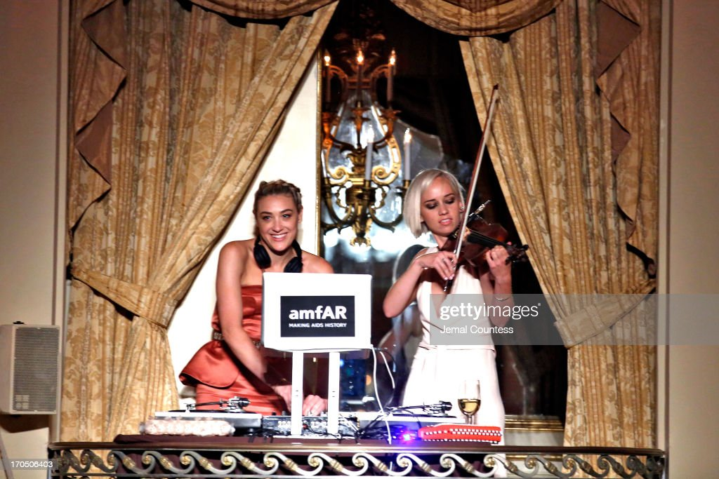 Musicians Mia Moretti (L) and Caitlin Moe of the Dolls perform during the 4th Annual amfAR Inspiration Gala New York at The Plaza Hotel on June 13, 2013 in New York City.