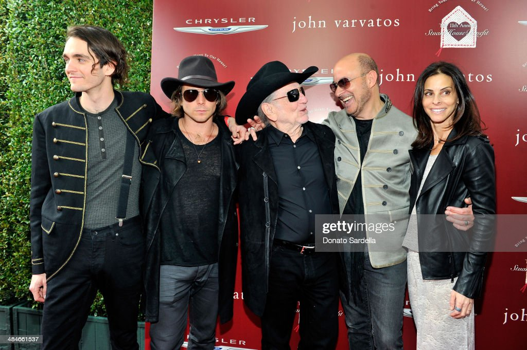 Musicians Micah Nelson Lukas Nelson Willie Nelson designer John Varvatos and wife Joyce Varvatos arrive at the John Varvatos 11th Annual Stuart House...