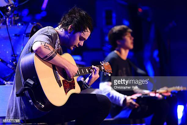 Musicians Michael Clifford and Calum Hood of 5 Seconds Of Summer perform onstage during Vevo Certified Live at Barker Hangar on August 17 2015 in...