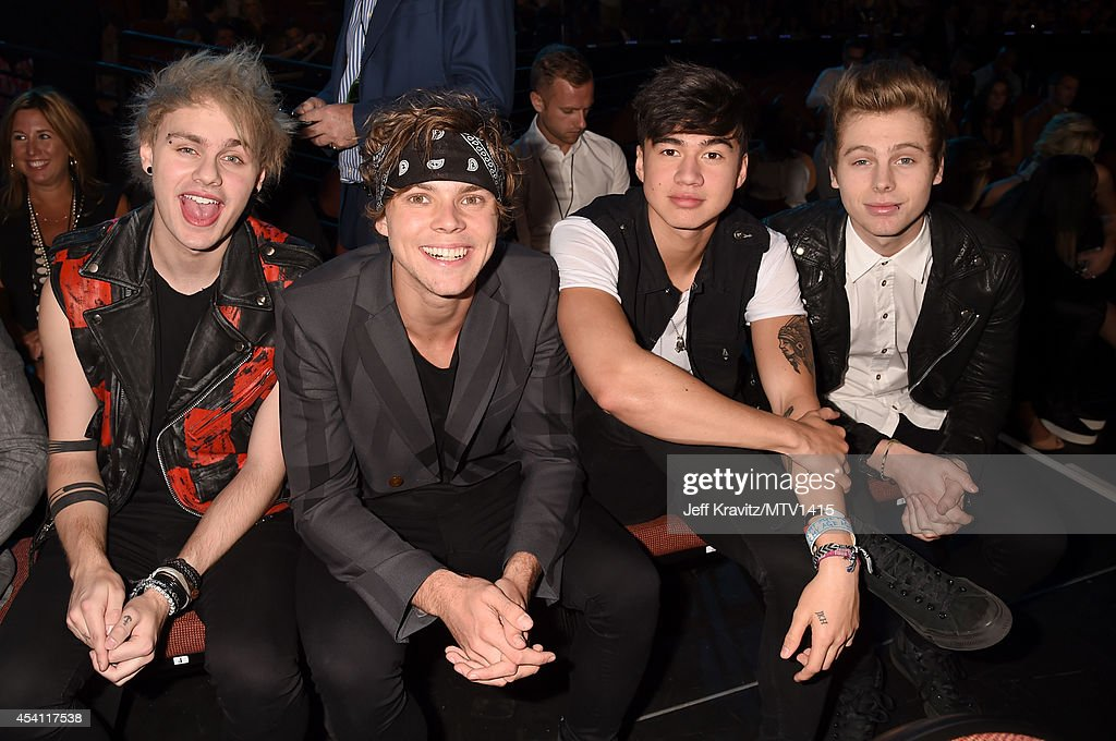 Musicians Michael Clifford, Ashton Irwin, Calum Hood and Luke Hemmings of 5 Seconds of Summer attend the 2014 MTV Video Music Awards at The Forum on August 24, 2014 in Inglewood, California.