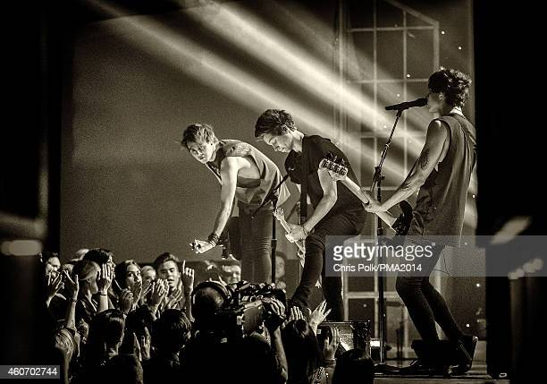 Musicians Michael Clifford Luke Hemmings and Calum Hood of 5 Seconds of Summer perform onstage during the PEOPLE Magazine Awards at The Beverly...