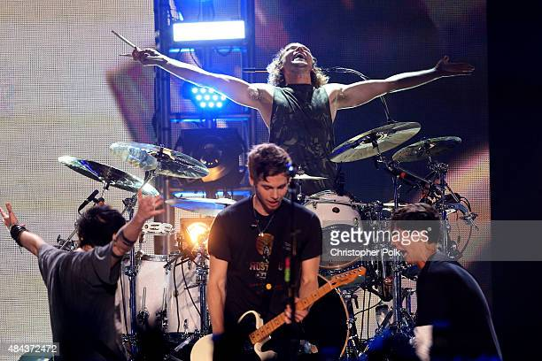 Musicians Michael Clifford Luke Hemmings Ashton Irwin and Calum Hood of 5 Seconds Of Summer perform onstage during Vevo Certified Live at Barker...