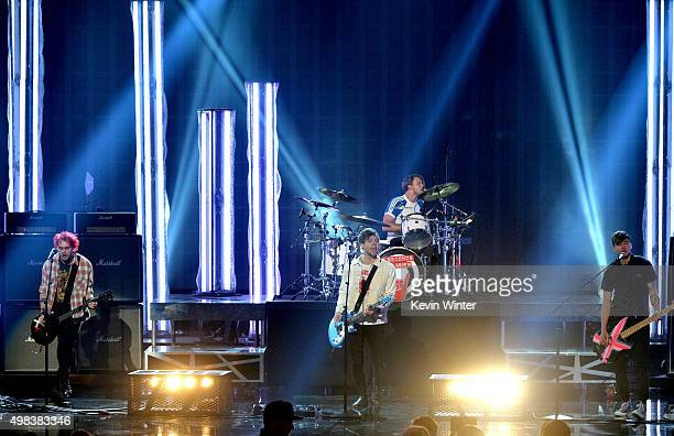 Musicians Michael Clifford Luke Hemmings Ashton Irwin and Calum Hood of 5 Seconds of Summer perform onstage during the 2015 American Music Awards at...